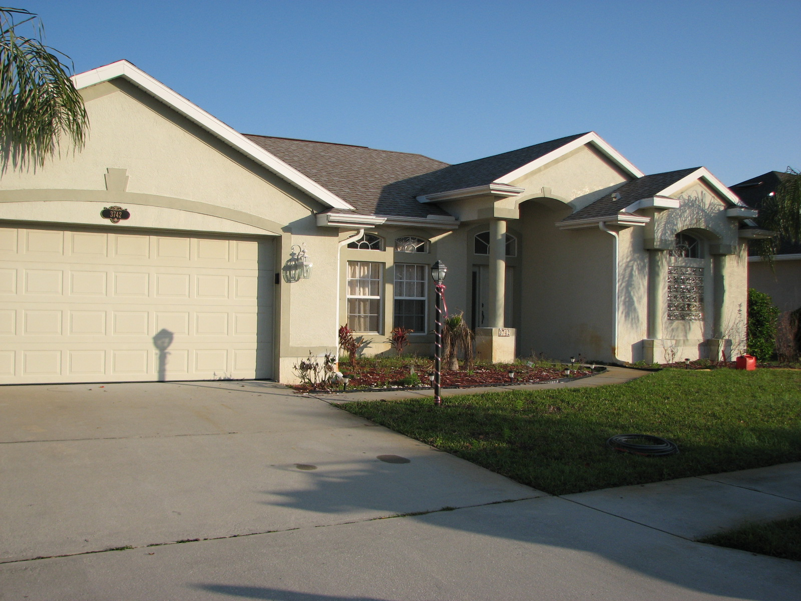 Exterior painting melbourne florida stucco cracks dingy - Painting a stucco house exterior ...