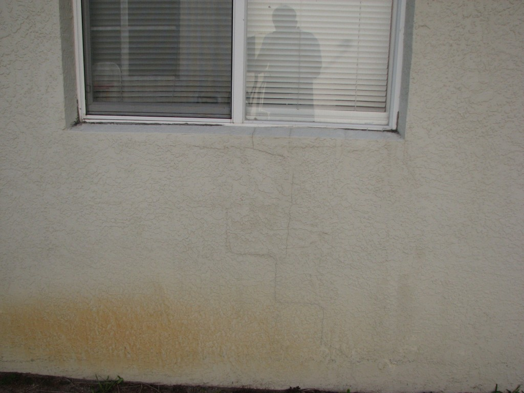 Stucco cracks- Exterior painting Melbourne FL Before