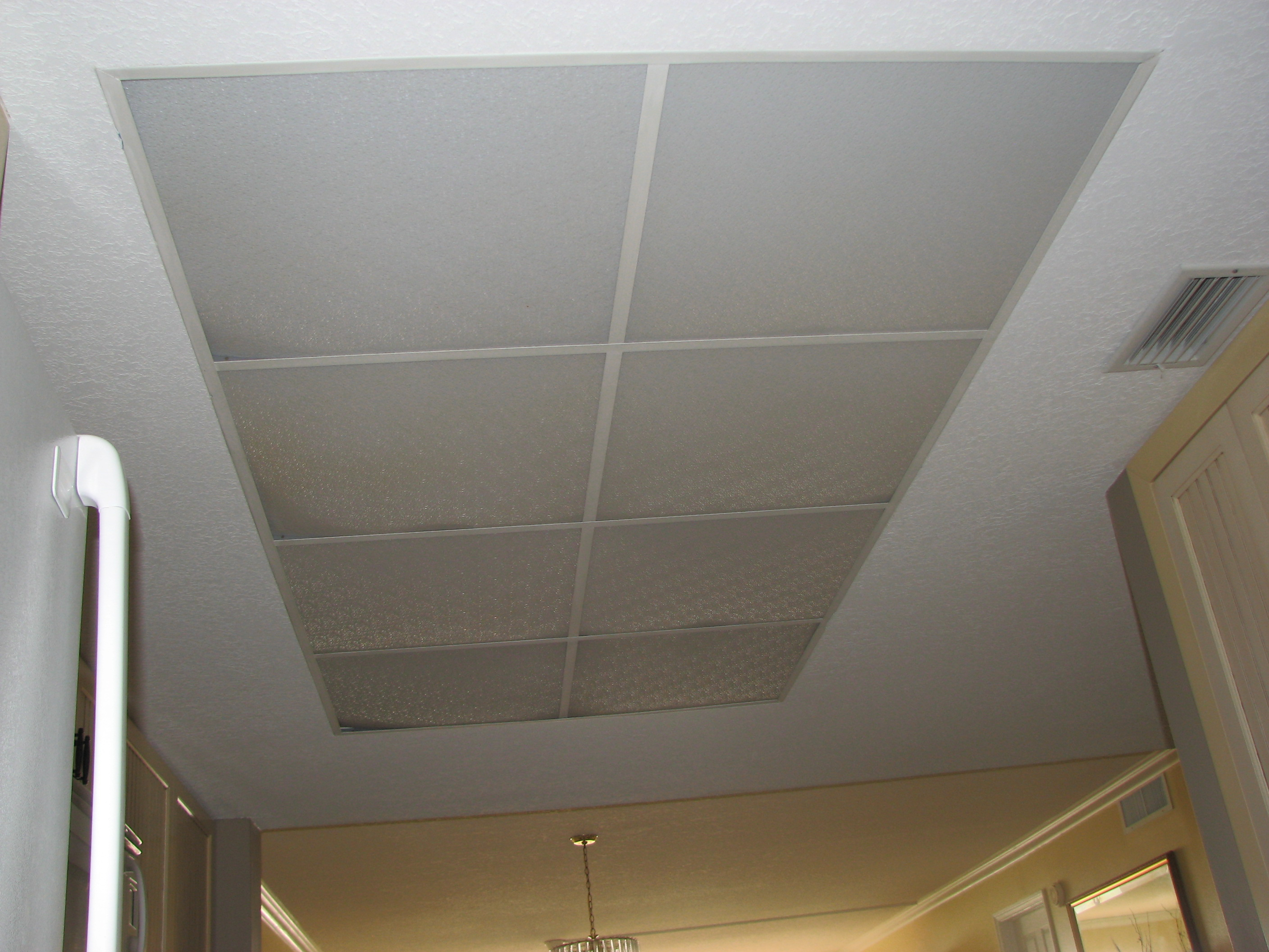Cocoa Beach condo kitchen ceiling light- Before