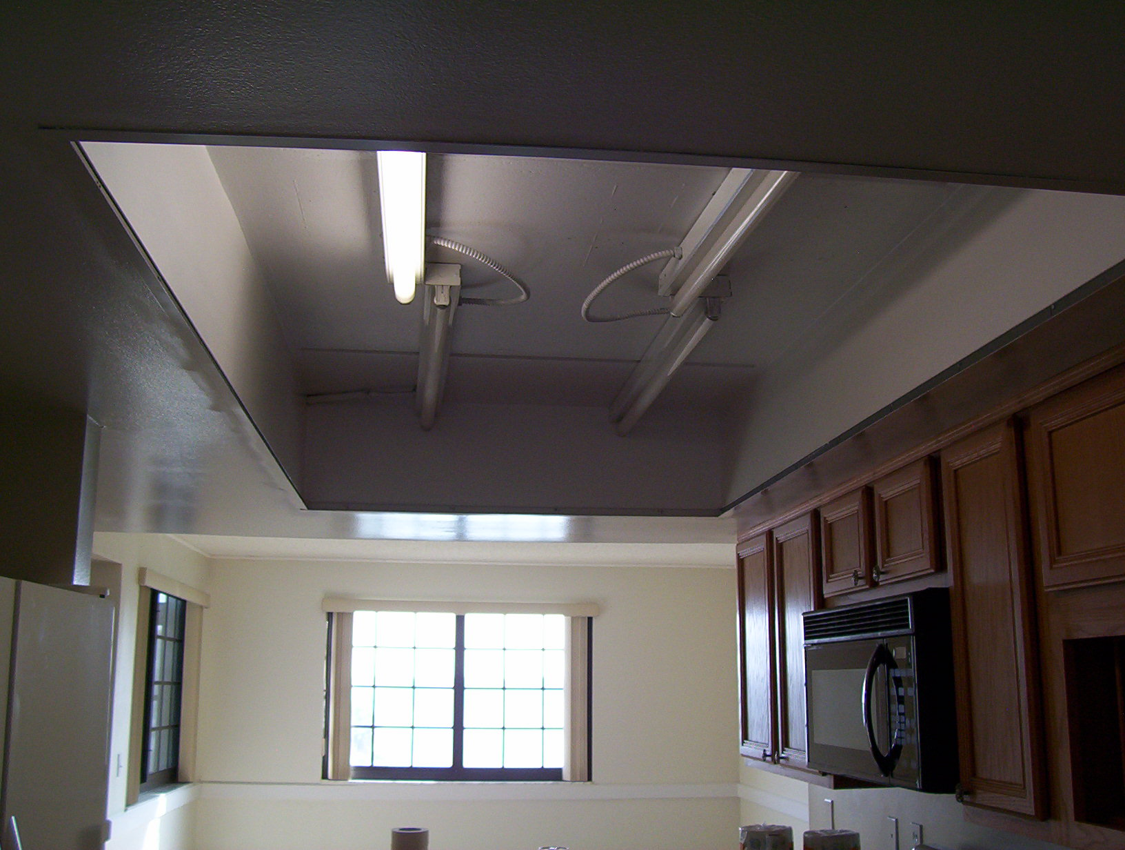Cocoa Beach condo kitchen grid ceiling removed