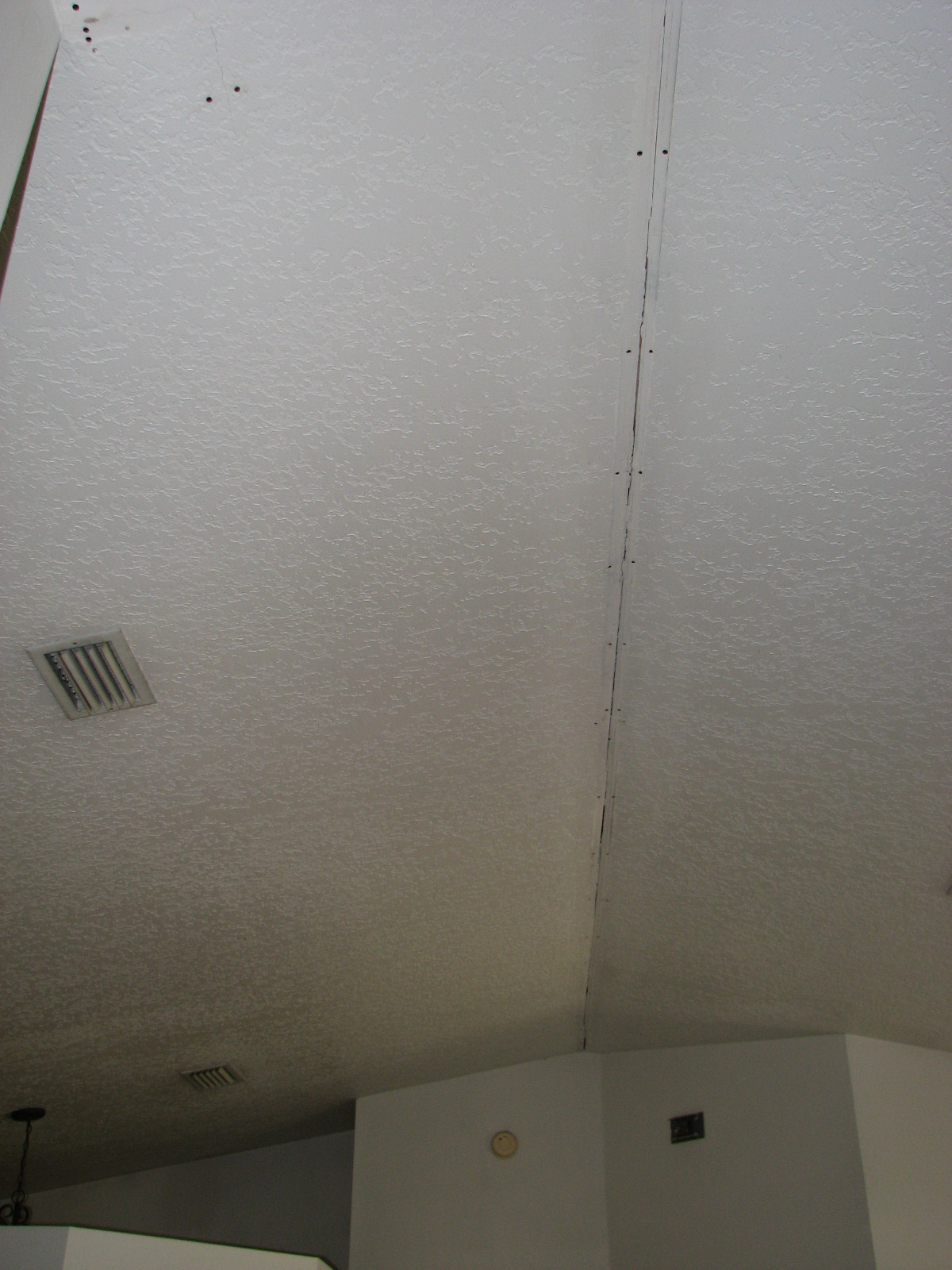 Vaulted ceiling tape joint repair by peck drywall and painting for Interior stucco ceiling repair