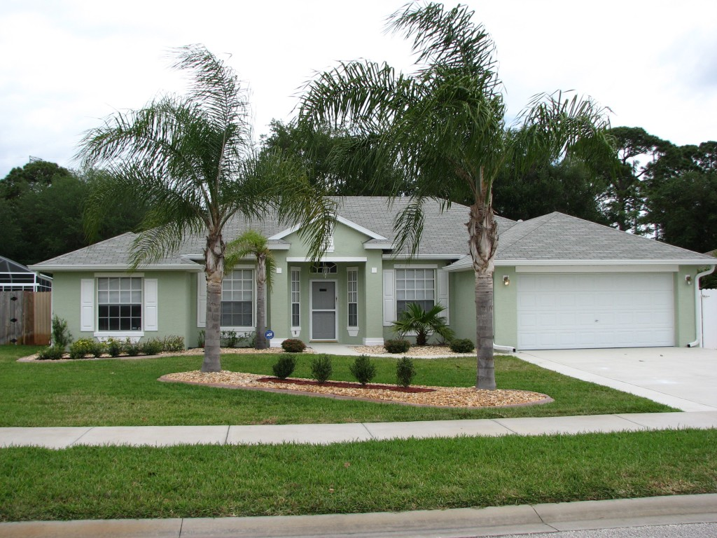Cocoa fl exterior house painting project by peck painting for Beach house gray paint colors