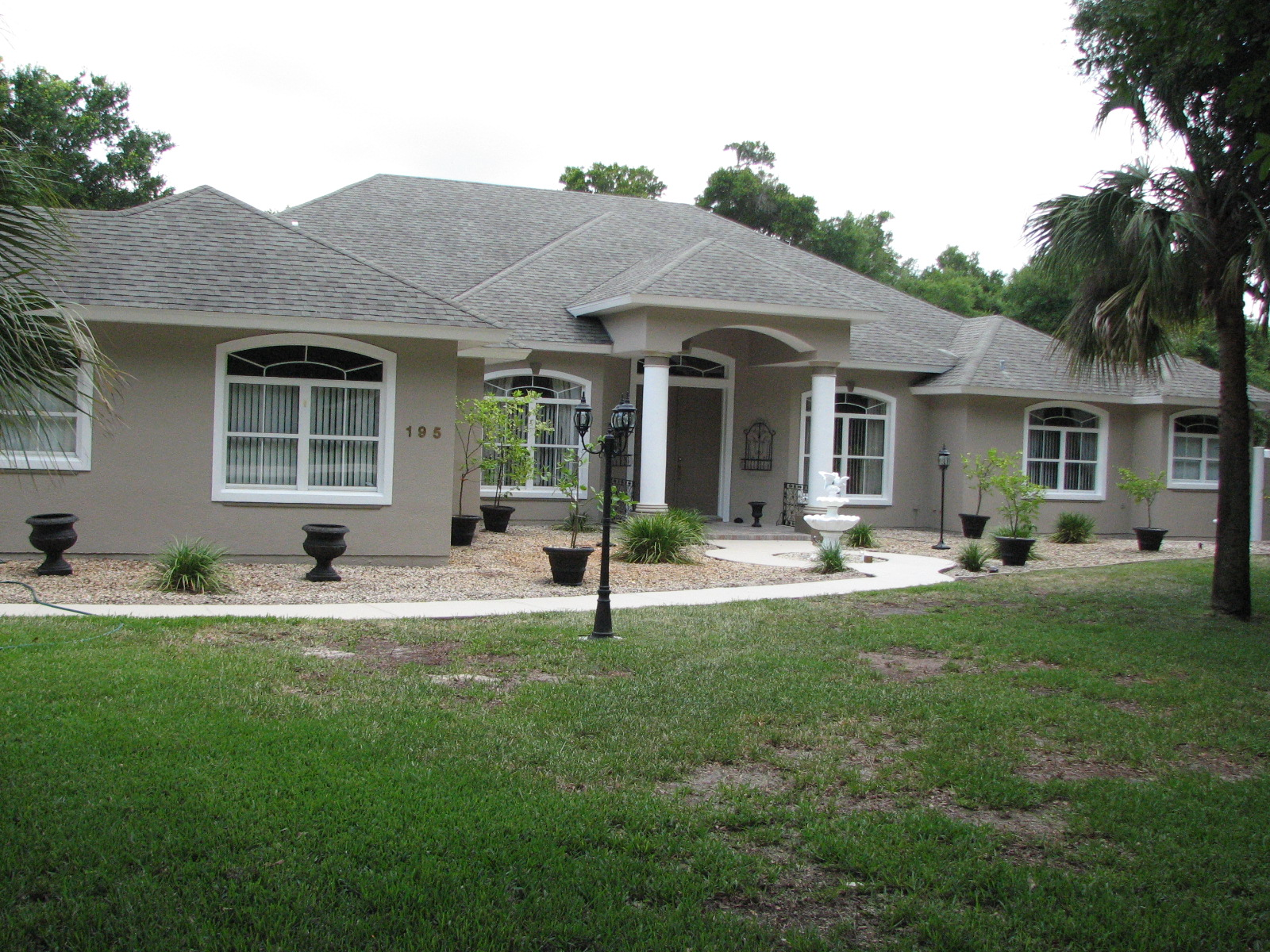 Cocoa fl exterior stucco painting after photo for Stucco colors for houses exterior