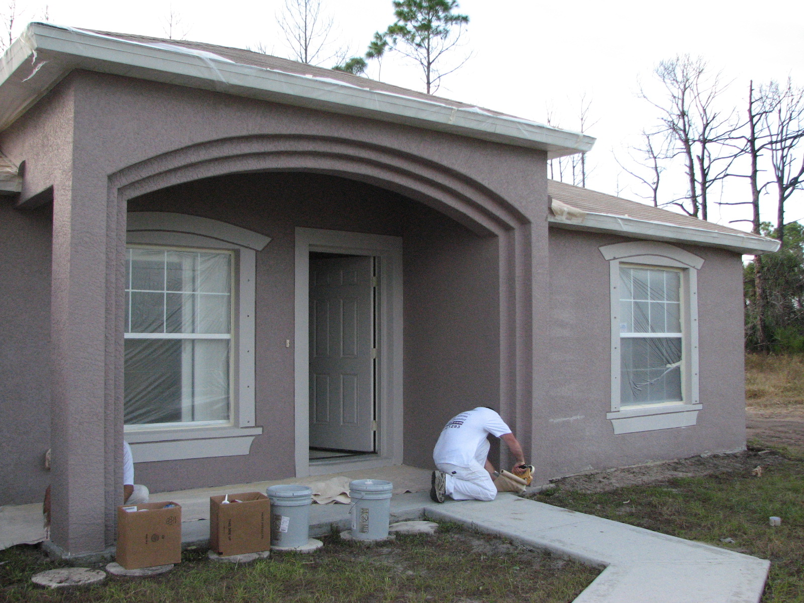 Stucco cracks archives peck drywall and painting for Garage door repair palm bay