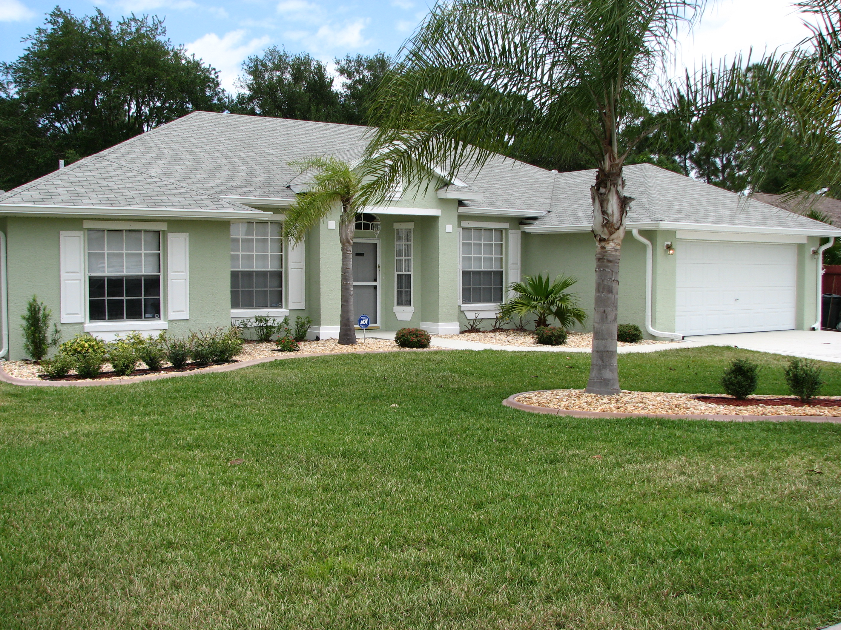 Cocoa fl exterior house painting project by peck painting for Stucco house paint colors