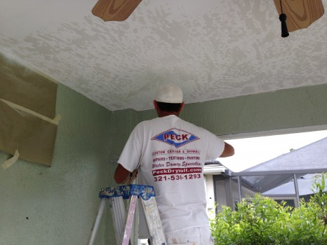Applying skip trowel texture to the ceiling